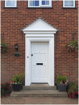 Example of a bespoke timber door from Rural Timber based in Worcester